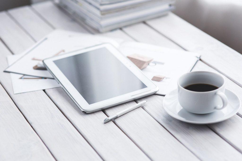 Karolina Grabowska_White Tablet And Cup Of Coffee_akFlRw